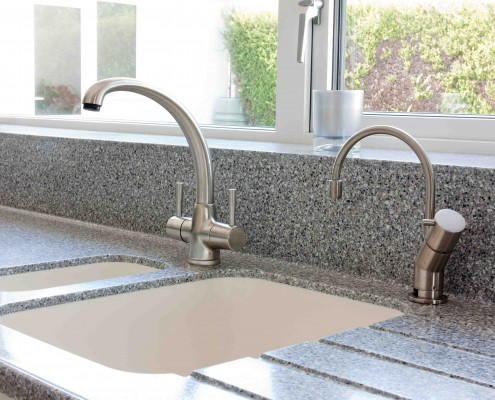 Modern kitchen granite worktop and ceramic sink with mixer tap